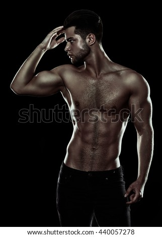 attractive fitness man, trained male body, lifestyle portrait, caucasian model. sexy fitness male model posing isolated on black background - stock photo