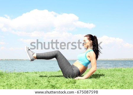 Attractive fitness woman exercising outdoors