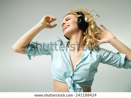 Attractive fitness woman with headphones - stock photo