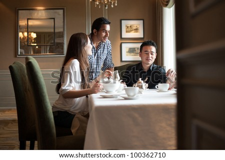 Attractive Friends in Cafe - stock photo