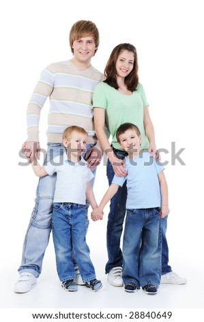 attractive full-length portrait of young happy family with two sons - stock photo