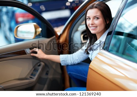 Attractive girl behind the wheel - stock photo