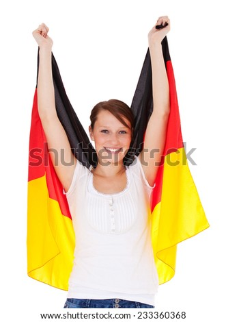 Attractive girl holding german flag. All on white background.