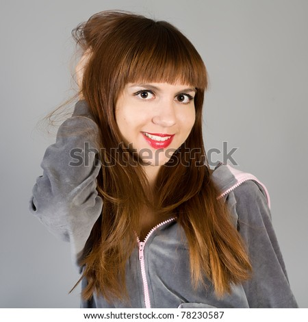 attractive girl in a gray jacket