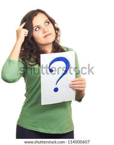 Attractive girl in a green shirt, holding a sheet of paper with a big question mark, and looks to the upper-left corner. Isolated on white background