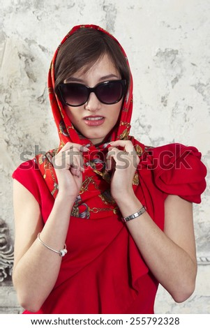Attractive girl in a scarf and sunglasses - stock photo