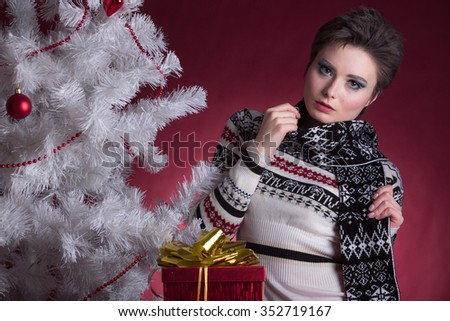 attractive girl in Christmas with gifts