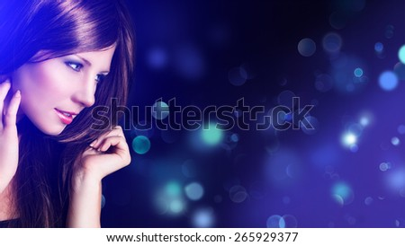 attractive girl in front of bokeh lights