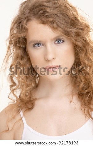 Attractive girl in gym suit looking at camera.? - stock photo