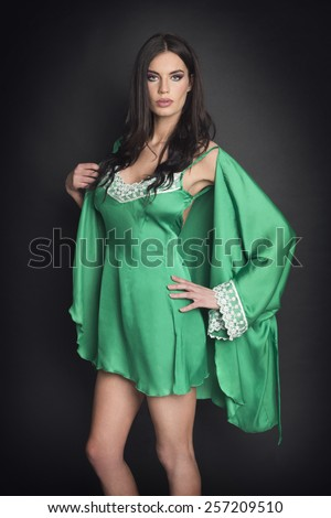 Attractive girl in sexy green lingerie - stock photo