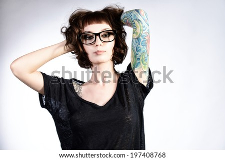Attractive girl in spectacles alluring in sexual clothes. Beauty, fashion. - stock photo