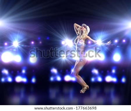 Attractive girl in swim wear dancing in party lights