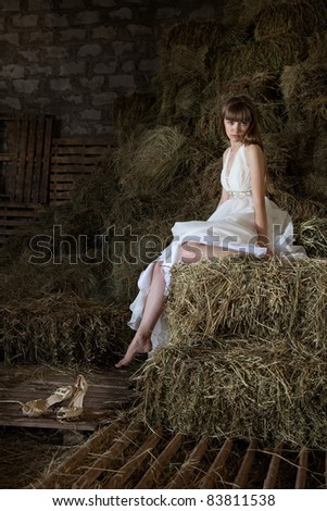attractive girl in the hay. runaway bride