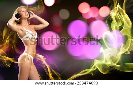 Attractive girl in white bikini and headphones on color background - stock photo