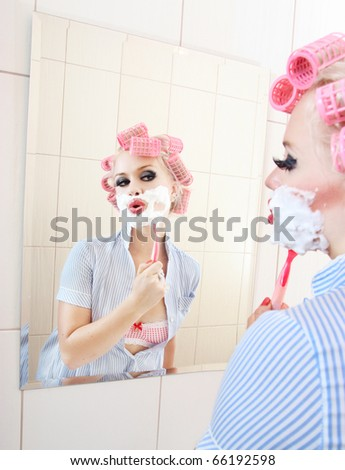 Attractive girl is having a shave, similar available in my portfolio - stock photo