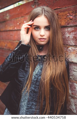Attractive girl on a background of a wooden backgrounds