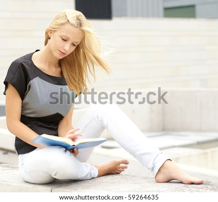 Attractive girl reading the book