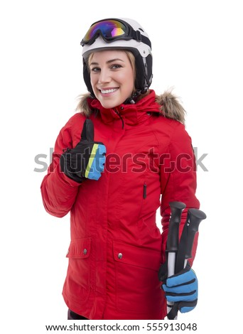 Attractive girl skier showing thumbs up on white background. Sportswoman in a red jacket in a ski suit.