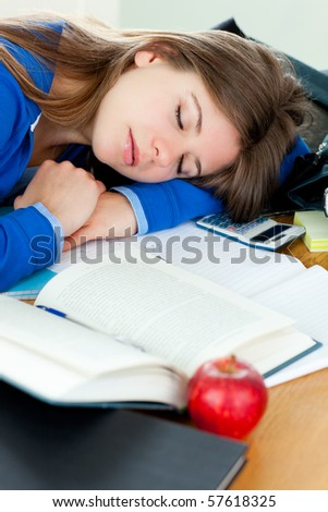 Attractive girl sleeping at her desk at home