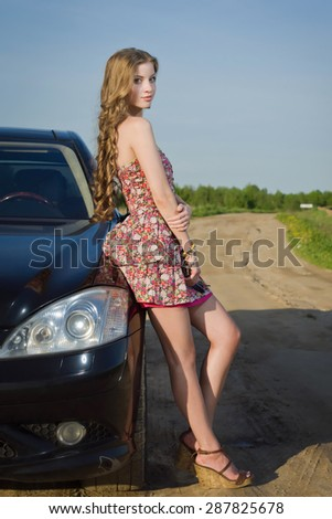 Attractive girl traveling with her car