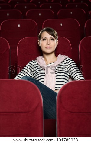 Attractive girl watching  movies alone - stock photo