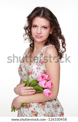 Attractive girl wearing clothes with floral ornament - stock photo