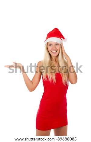 attractive girl wearing red Christmas hat, holding hand palm up with empty cope space for product, Isolated over a white background - stock photo