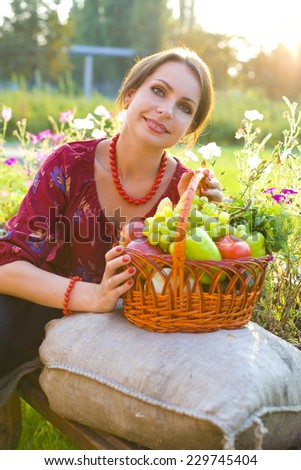 attractive girl with a basket of fruit and vegetables