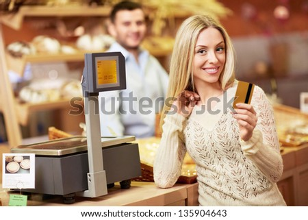 Attractive girl with a credit card