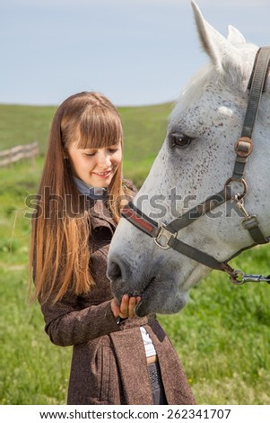 attractive girl with a horse on nature