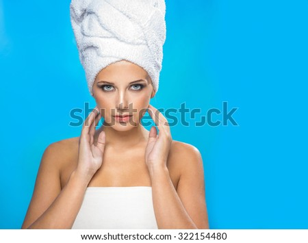 Attractive girl with a white towel on the head - stock photo