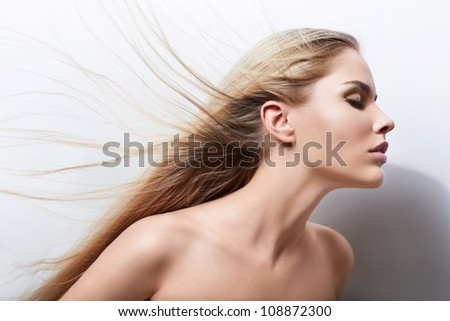 Attractive girl with beautiful hair - stock photo