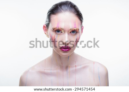 Attractive girl with bright makeup on a white background in the studio, the concept of beauty and health - stock photo