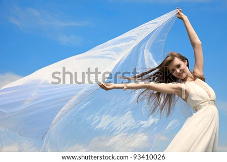 attractive girl with flying material. outdoor shot