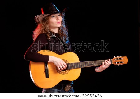 Attractive girl with guitar in the hands - stock photo