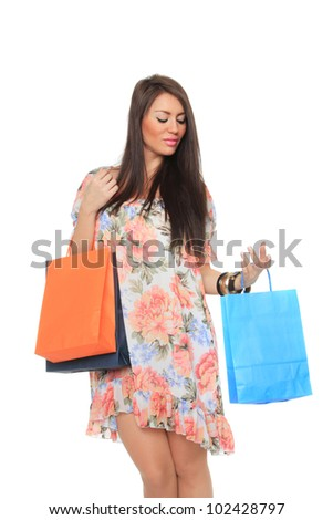 Attractive girl with shopping bags on white background