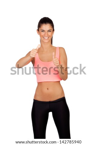 Attractive girl with sports clothes saying Ok isolated on a white background