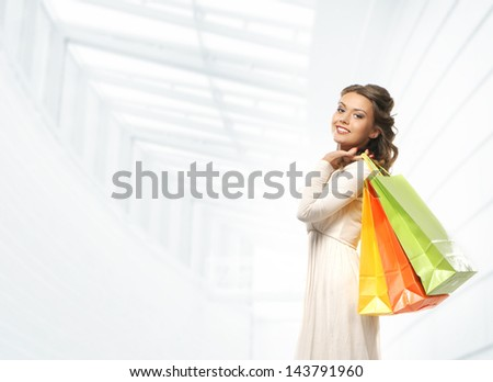 Attractive girl with the bright shopping bag - stock photo