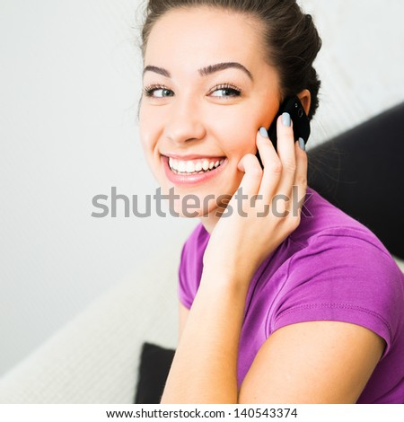 Attractive girl woman speaking by her cell phone - stock photo