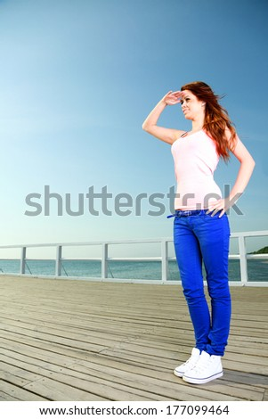 Attractive girl Young woman looking on background of sky - stock photo