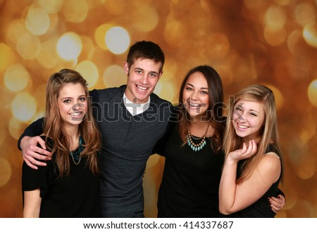 attractive group of older teen friends laughing