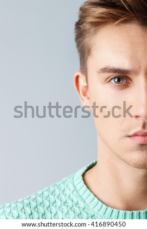 Attractive guy is staring with seriousness - stock photo