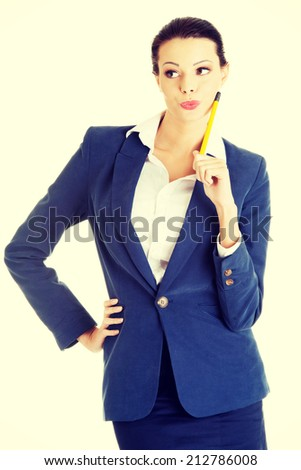 Attractive happy businesswoman with pen, isolated on white
