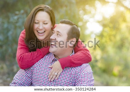 Attractive Happy Caucasian Couple Laughing Outdoors. - stock photo