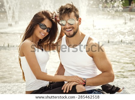 Attractive happy couple in sunglasses - stock photo