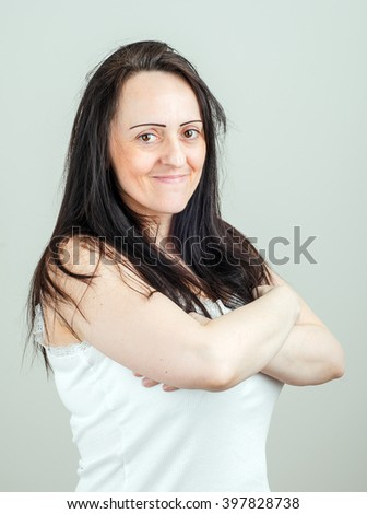 Attractive happy middle aged woman with folded arms. Portrait with copy space. - stock photo