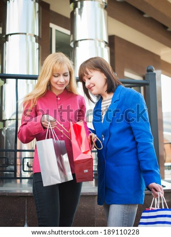 Attractive happy women with shopping bags. Shopping.