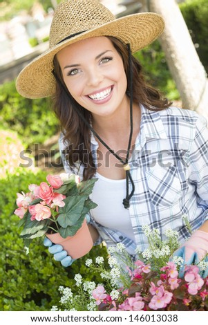https://thumb1.shutterstock.com/display_pic_with_logo/100760/146013038/stock-photo-attractive-happy-young-adult-woman-wearing-hat-gardening-outdoors-146013038.jpg