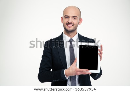 Attractive happy young business man holding blank screen tablet over white background - stock photo