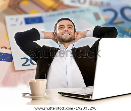 Attractive Happy Young Business Man with beard  sitting at office desk leaning back on his chair Thinking and Dreaming of Big Money over Euro Currency Background - stock photo